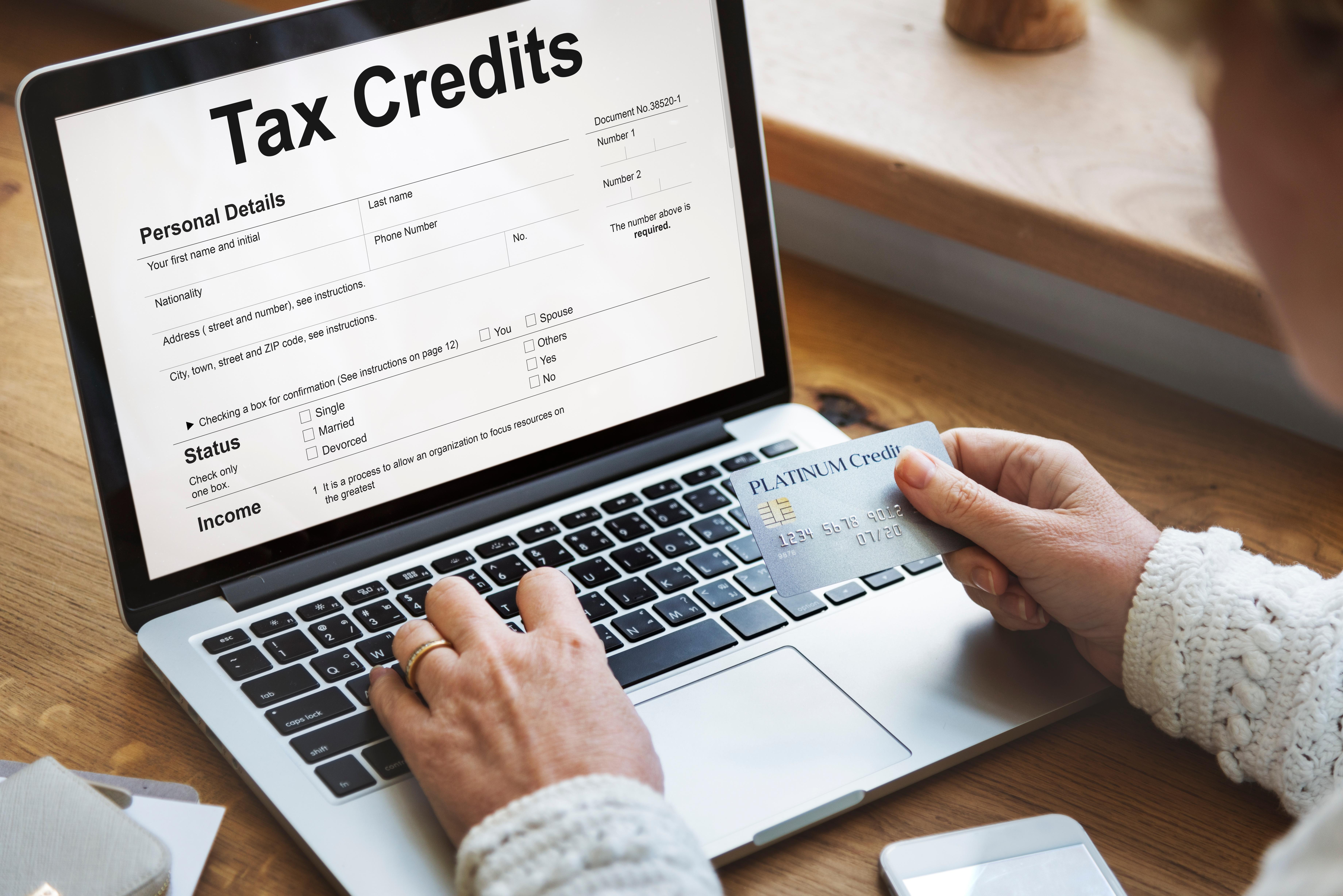 tax-credits-claim-return-deduction-refund-concept-PQ22EP9
